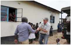 Head Teacher Mwanza Shadreck greets Connect Africa Director Dion Jerling