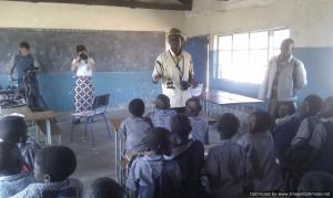 Lloyd explaining to the children